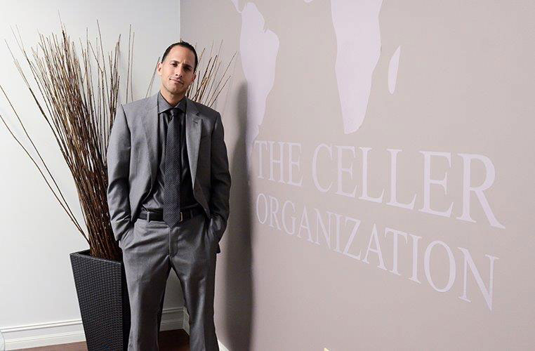 Bobbie Celler standing next to the Celler Organization Painted Wall